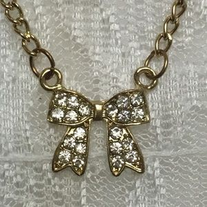 Rhinestone Bow Tie Necklace Gold Tone